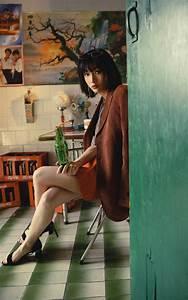 beautiful stylish asian wearing a coat and a