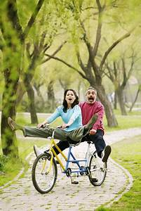 Couple having fun cycling in the park Stock Photo - 1680542 | StockUnlimited
