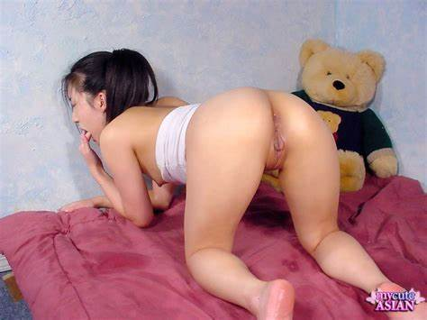 Nice Chinese Shows Her Pigtailed Cunts On A Sofa