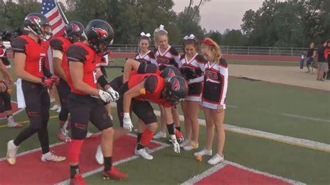 high school football team takes   field
