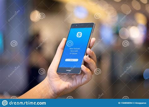 Users may exchange such digital documents as images, text. CHIANG MAI, THAILAND - Oct. 28,2018: Man Holding HUAWEI ...