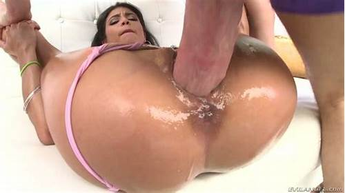 Oiled Up Curly Banged Herself With A Giant Penis