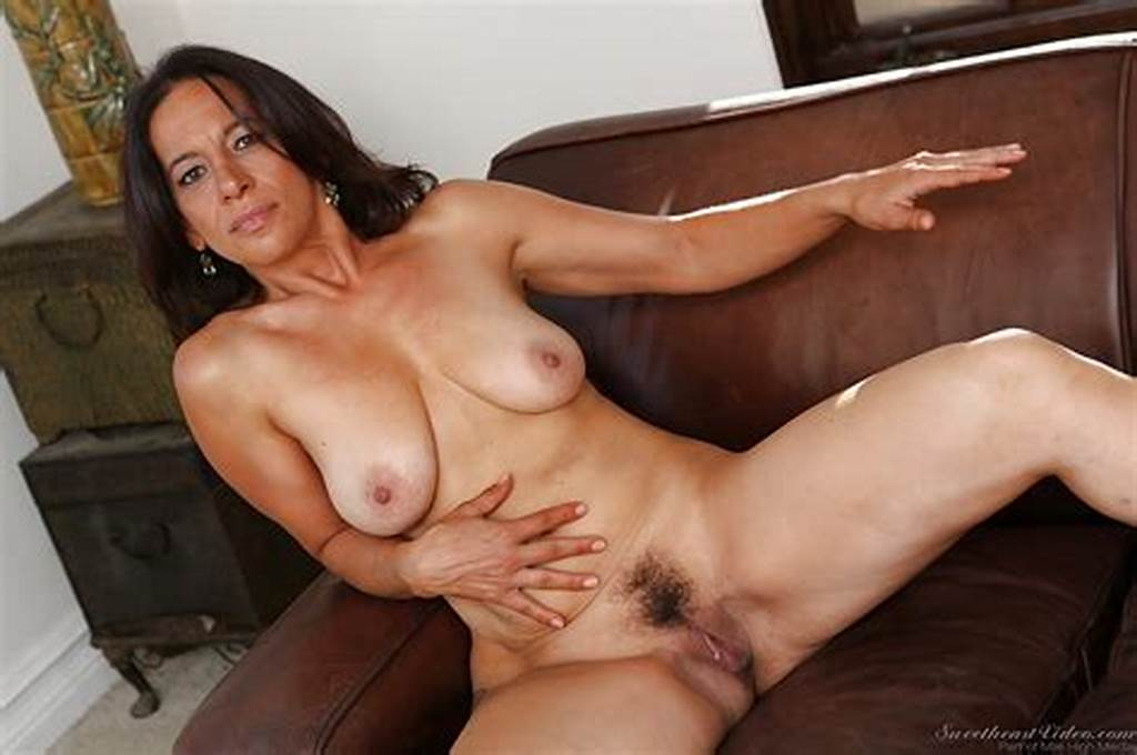 #Mature #Brunette #Melissa #Monet #Stripping #And #Spreading #Her