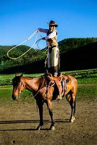 Cowboys, Cowgirl, Standing, On, Horse, Saddle, Swinging, Lasso