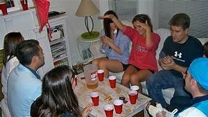 Girls and bys playing strip poker