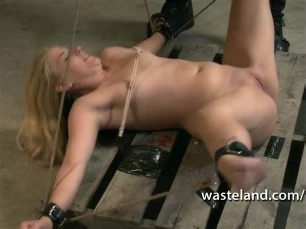 #Blonde #Womens #Legs #Are #Spread #Wide #By #Rope #Showing #Her