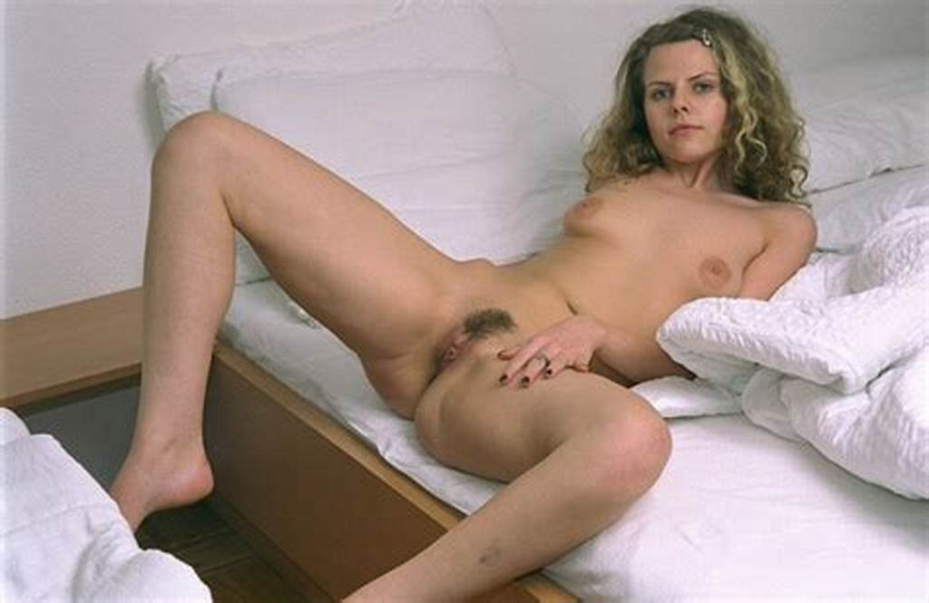 #Lying #On #The #Bed #Slutty #Chick #Masses #Her #Smooth #Nude #Legs