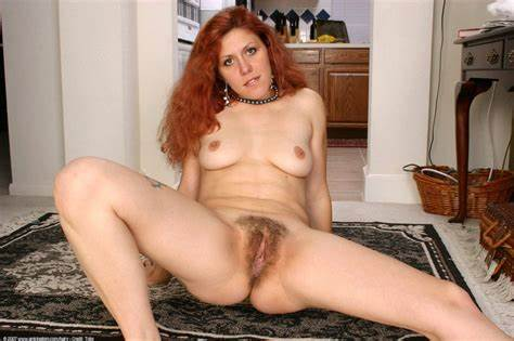 Curly Redhead Prostitute In Heels