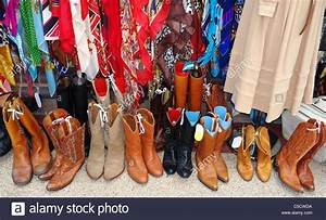Second, Hand, Clothing, And, Boots, For, Sale, Displayed, Outside
