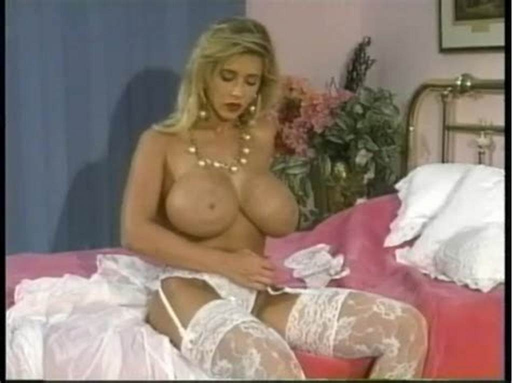 #80S #Pornstar #With #Huge #Tits #Rubs #Lotion #Into #Her #Skin