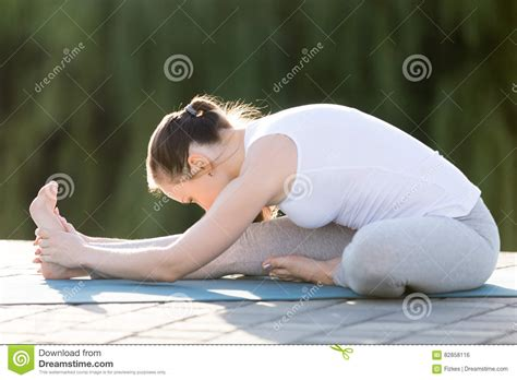 It is a stretch designed to improve flexibility and limberness. Janu Sirsasana pose stock photo. Image of active, posture - 82858116