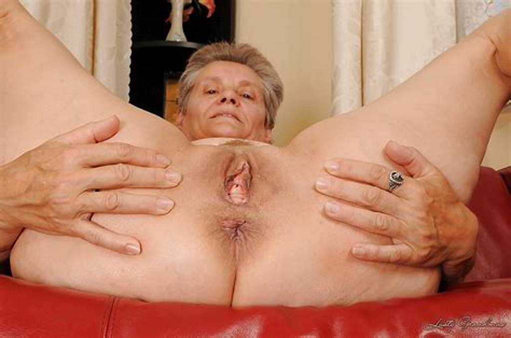 #Raunchy #Granny #With #Massive #Jugs #Stripping #And #Spreading