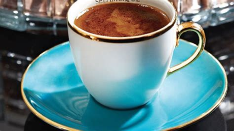 Combine cardamom and ground coffee with boiling water and let it foam multiple times to enjoy this spiced delicacy! How to enjoy Arabic Coffee   Departures Magazine