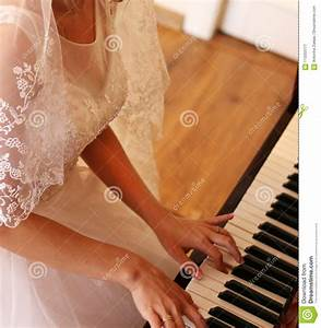 Bride Playing The Piano Stock Image  Image Of Dress