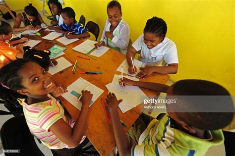 Each time the driver saw a child — especially a young teen — he would stick his head out of the window and shout. Daylife after the earthquake. Children Drawing In Class, Port Au... News Photo - Getty Images