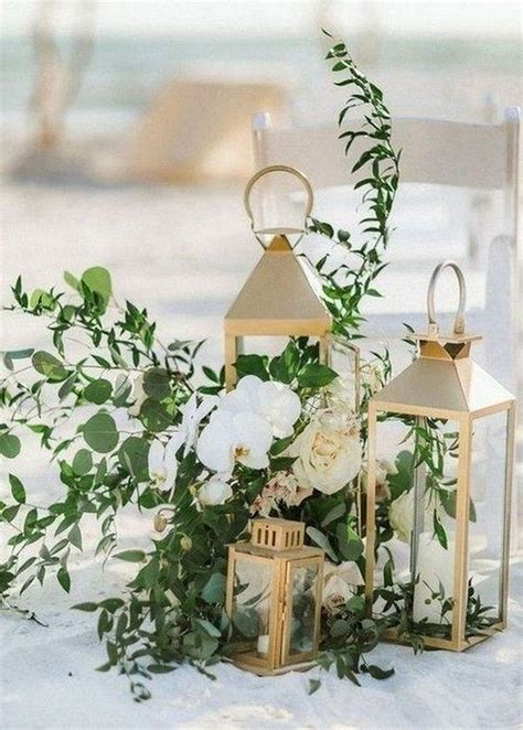 beach wedding aisle decoration ideas with lanterns and